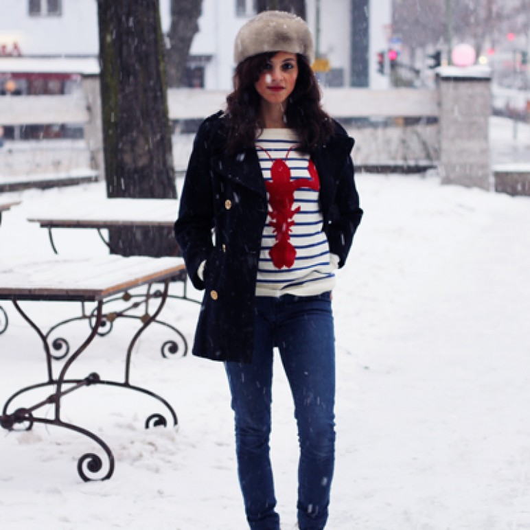 Studded sneakers and lobster sweater