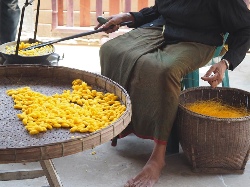 Woman spooling silk