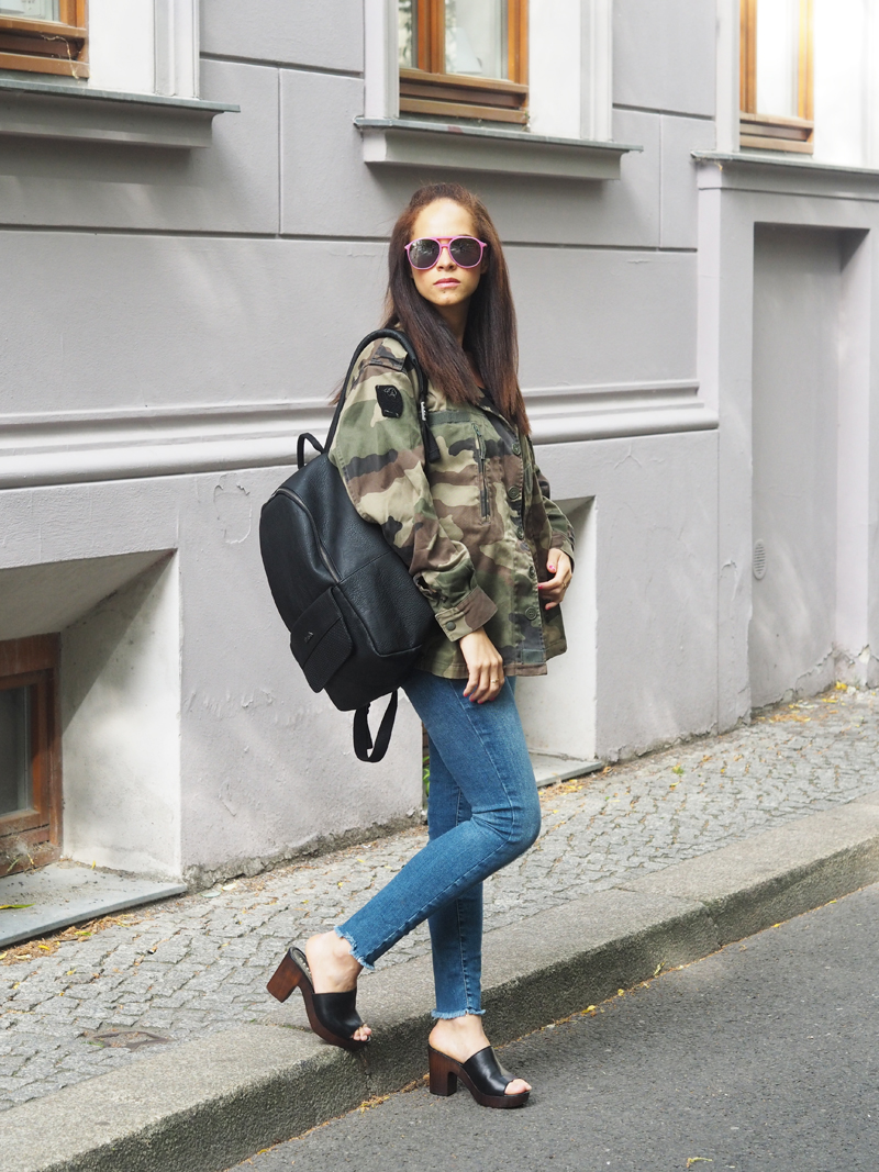 amandine fashion blogger berlin germany wearing military vintage camouflage jacket black leather backpack hayne bench mules office shoes uk wildfox barbie sunglasses pink ootd outfit
