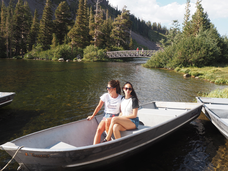travel bloggers on a boat at Mammoth lakes California road trip