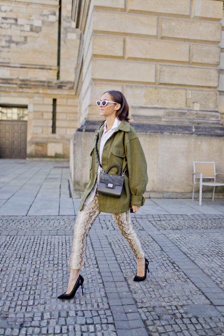 Styling snake print trousers