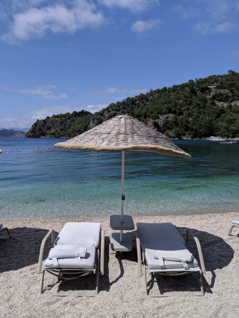 Hillside beach club Fethiye Turkey sunchairs